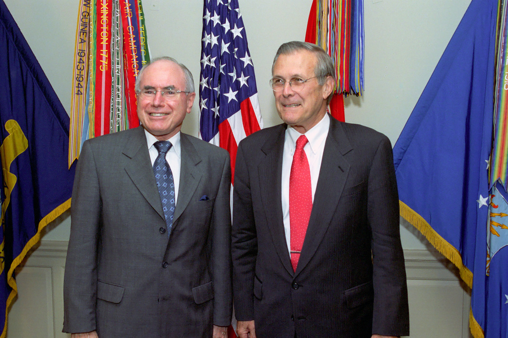 The Honorable Donald H. Rumsfeld (right), U.S. Secretary of Defense, poses with Australian Prime Minister John Howard, in the Pentagon, where they will discuss the principles of submarine operations. (DoD photo by Robert D. Ward) (Released)
