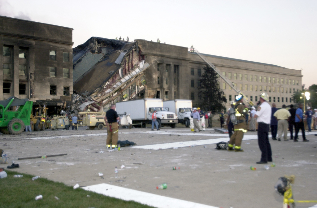 A view of the damage done to the Western ring of the Pentagon Building as firefighters conduct rescue operation, hours after American Airlines Fight 77 was piloted by terrorists into the building, during the September 11, 2001 attacks