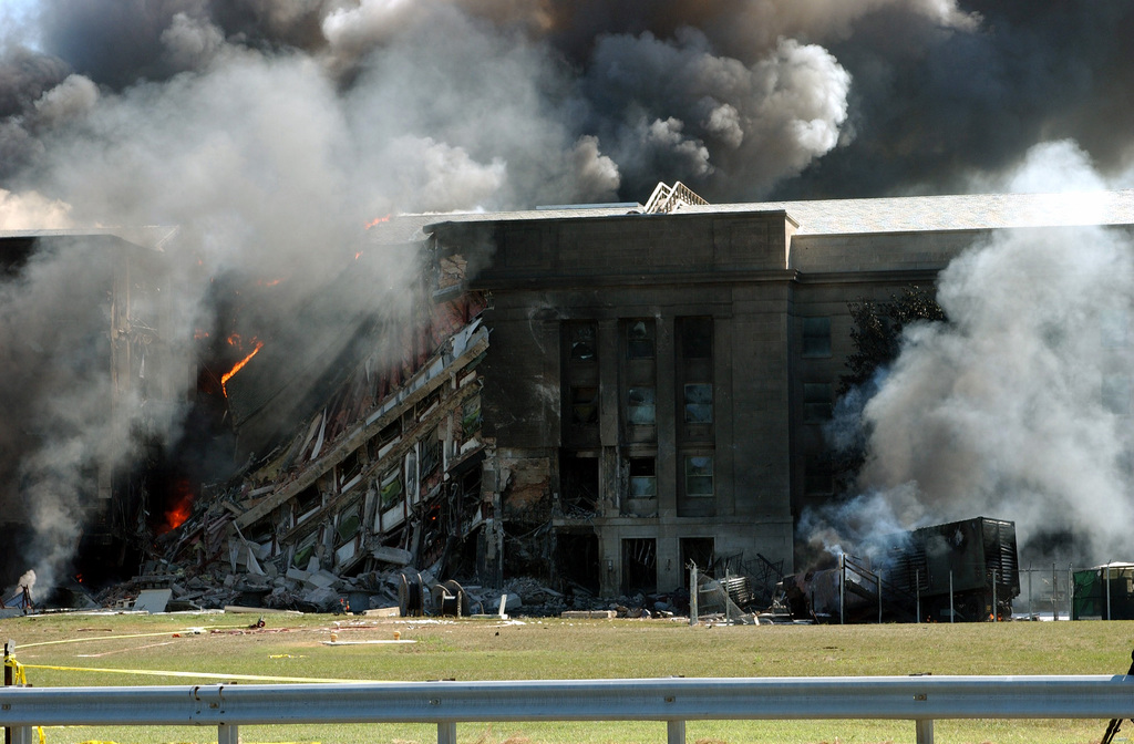 Firefighters work to put out the flames moments after a hijacked jetliner crashed into the Pentagon at approximately 0930 on September 11, 2001