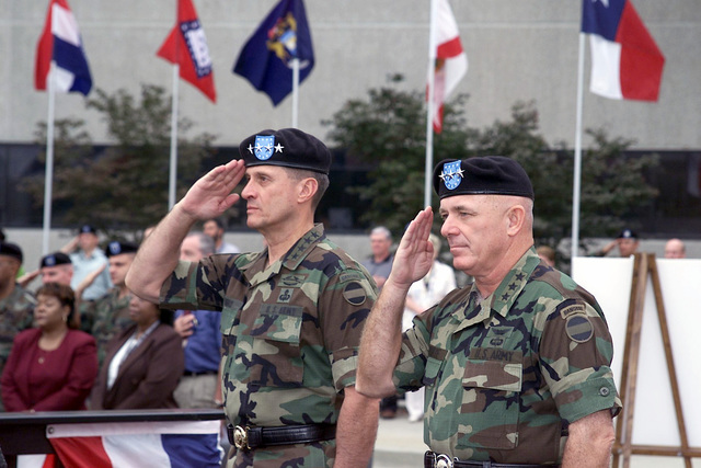 General (GEN) John W, Hendrix (left), USA, Commanding General US Army Forces Command, and Lieutenant General (LGEN) Leon J. LaPorte, USA, Deputy Commanding General for Forces Command, render salutes during a Welcoming Ceremony held at Headquarters Forces Command for LGEN LaPorte