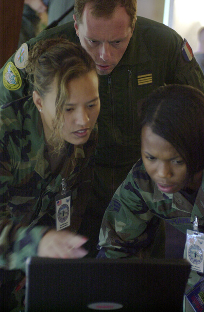 Major Francois Hebrard, (center) French Air Force New Caledonia, STAFF Sergeant Michelle Mister, and SENIOR AIRMAN Ebony Shephard, (right), both from the 13th Air Force, Andersen Air Force Base, troubleshoot the Majors presentation. PACIFIC AIRLIFT RALLY (PAR) 2001 is a PACAF-sponsored Military Airlift symposium for countries in the pacific region. PAR, held every two years and hosted by a pacific nation, this year Guam is the host nation with the symposium staging out of Andersen AFB. The symposium includes informational seminars with area of expertise briefings, a Command Post Exercise (CPX) which addresses military airlift support to a humanitarian airlift/disaster relief scenario, ...