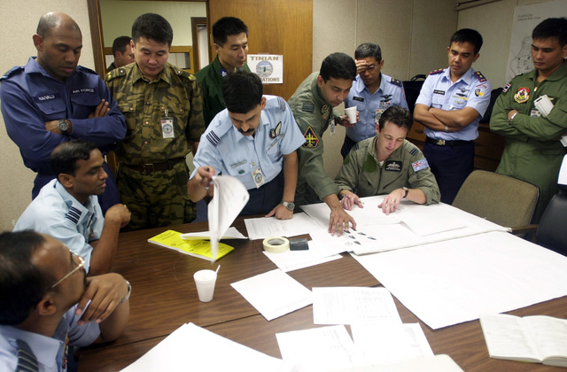 Squadron Leaders and Commanders of participating countries discuss events and scenarios that will take place on the flightline of Andersen AFB, Guam during the PACIFIC AIRLIFT RALLY 2001. PACIFIC AIRLIFT RALLY (PAR) is a PACAF-sponsored Military Airlift symposium for countries in the pacific region. PAR, held every two years and hosted by a pacific nation, this year Guam is the host nation with the symposium staging out of Andersen AFB. The symposium includes informational seminars with area of expertise briefings, a Command Post Exercise (CPX) which addresses military airlift support to a humanitarian airlift/disaster relief scenario, and a concurrent flying training program that builds ...
