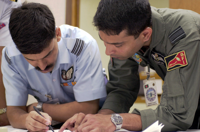 Squadron Leaders B.S. Kanwar, (left), Indian Air Force, and Shaheed Al-Mamun, Bangladesh Air Force, discuss flightline activities at Andersen AFB, Guam during PACIFIC AIRLIFT RALLY 2001. PACIFIC AIRLIFT RALLY (PAR) is a PACAF-sponsored Military Airlift symposium for countries in the pacific region. PAR, held every two years and hosted by a pacific nation, this year Guam is the host nation with the symposium staging out of Andersen AFB. The symposium includes informational seminars with area of expertise briefings, a Command Post Exercise (CPX) which addresses military airlift support to a humanitarian airlift/disaster relief scenario, and a concurrent flying training program that builds ...