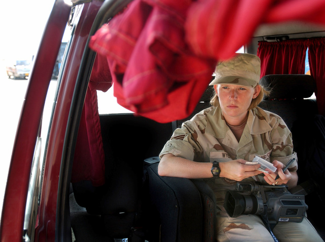 US Air Force (USAF) STAFF Sergeant (SSGT) Misty Wyen, 1ST Combat Camera Squadron waits inside a vehicle for her Egyptian escort during Exercise BRIGHT STAR 01-02. Bright Star is a multi-national exercise involving more than 74,000 troops from 44 countries that enhances regional stability and military cooperation among US Military our key allies, and our regional partners