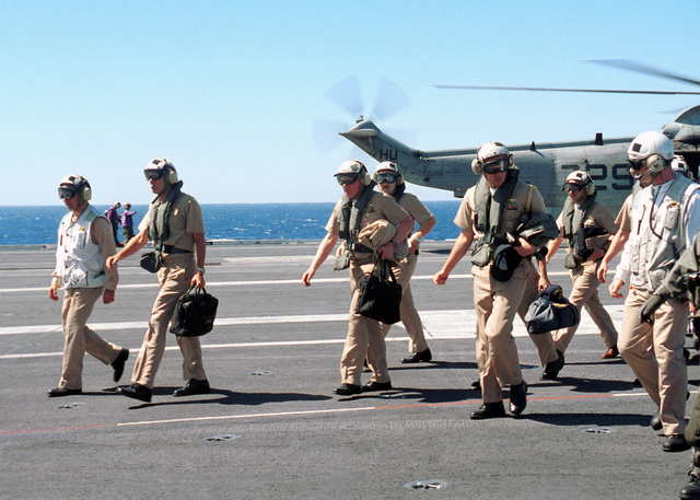 US Navy (USN) Vice Admiral (VADM) J. Cutler Dawson, Jr. (second from left), Commander, USN Second Fleet, and members of his staff, arrive on board the aircraft carrier USS GEORGE WASHINGTON (CVN 73) to plan and prepare for contingency operations in the aftermath of the World Trade Center and Pentagon attacks