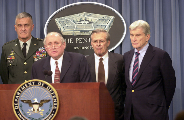 U.S. Senator Carl Levin (D-Michigan) fields a question during the first Pentagon press briefing following the September 11, 2001 attacks. U.S. Army GEN. Henry Shelton, Chairman, Joint CHIEF-of-STAFF; The Honorable Donald Rumsfeld, U.S. Secretary of Defense; and U.S. Senator John Warner (R-Virginia), stand in the background. (DoD photo by PETTY Officer 2nd Class Jim Watson) (Released)