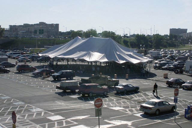 A tent erected on the Pentagon south parking lot September 12, 2001, to manage recovery efforts in the aftermath of the September 11th terror attack. Shortly after 8 a.m. on September 11, 2001 in an attempt to frighten the American people, five members of Al-Qaida, a terrorist group of fundamentalist Muslims, hijacked American Airlines Flight 77, a Boeing 757-200, shortly after it took off from Dulles International Airport just outside Washington DC. The hijackers herded up the 64 passengers toward the rear of the aircraft using knives and paper cutters then flew a circuitous route that took them away then back toward Washington. At about 9:45 a.m. they flew the aircraft and passengers...
