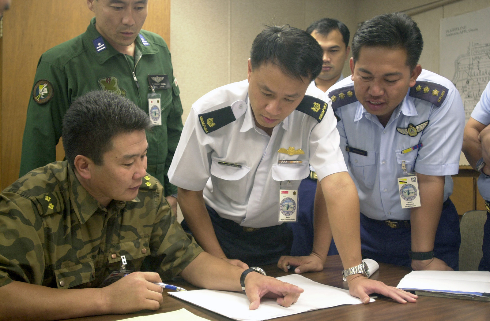 Lieutenant Colonel J. Batsukh, (left), Foreign Relations Officer, Mongolia, explains his plan for deployment of the C-130 Hercules to Major Francis Ngooi Choong Ngee, (center), Air Operations Department, Singapore and Captain Matyussof bin Matyassin, Training no. 4 Squadron, Brunei, at the PACIFIC AIRLIFT RALLY 2001. PACIFIC AIRLIFT RALLY (PAR) is a PACAF-sponsored military airlift symposium for countries in the pacific region. PAR is held every two years and is hosted by a pacific nation. This year Andersen AFB, Guam is the host nation. The symposium includes informational seminars with area of expertise briefings, a command post exercise (CPX) which addresses military airlift support ...