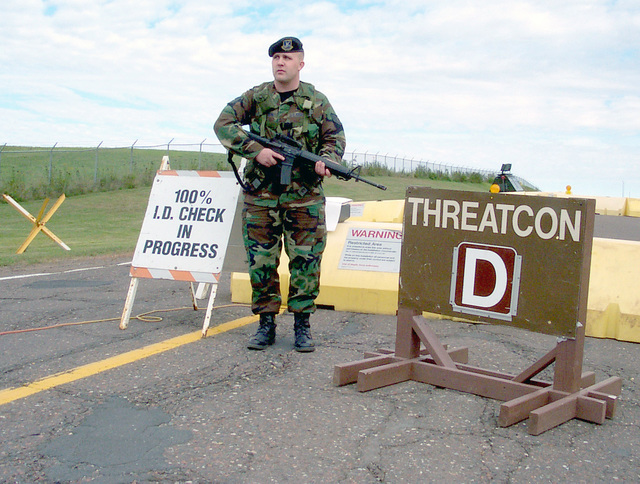 STAFF Sergeant Christopher Johnson, 148th Security Forces Squadron, Duluth Air National Guard, Duluth International Airport (IAP), Minnesota, stands vigilant at one of the Wing's displaced entry control points on September 12, 2001. Force Protection condition Delta was implemented at the Wing as a direct result of the terrorists attacks on September 11, 2001 in New York and Washington D.C
