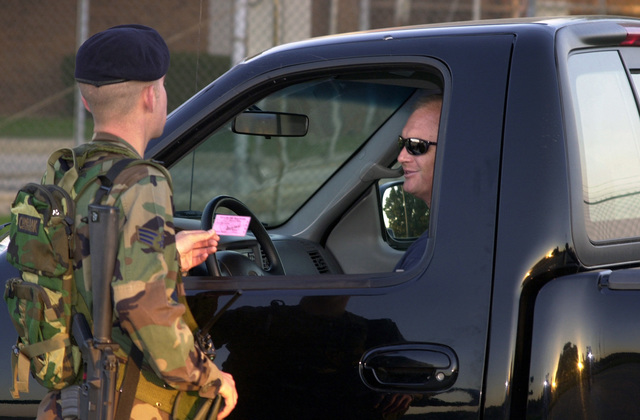 After the terrorist attacks in New York, Pennsylvania, and the Pentagon, mandatory I.D. checks is now an everyday occurrence. Here a SENIOR AIRMAN from the 183rd Security Forces Squadron checks the identification of an employee entering the Capitol Airport, home of the 183rd Fighter Wing, Illinois Air National Guard