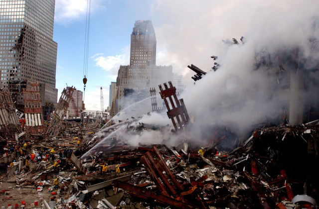 Fires still burn amidst the rubble and debris of the World Trade Centers in New York City in the area known as Ground Zero two days after the 9/11 terrorists attacks