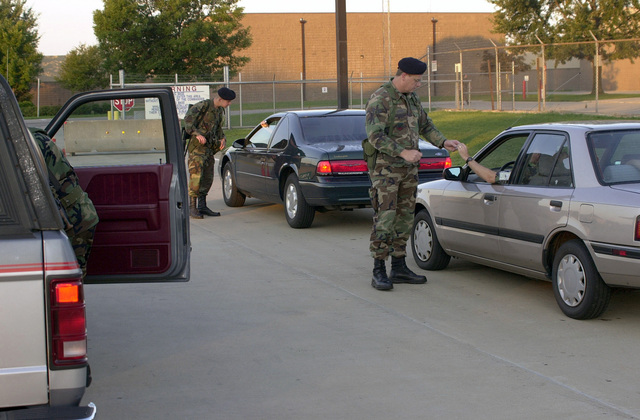 With heighten alertness personnel from the 183rd Security Forces Squadron now take a team approach to base entry procedures at Capitol Airport, Springfield, Illinois, home of the 183rd Fighter Wing, during drill weekends, when the volume of traffic is much heavier