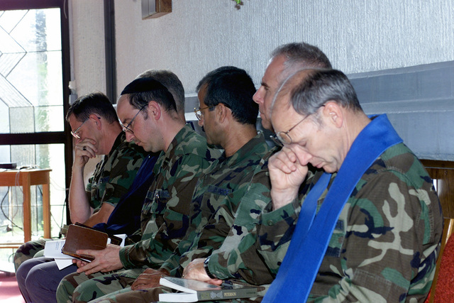 86th Airlift Wing Free Methodist Chaplain, Lieutenant Colonel Rex Carpenter, USAF, (foreground), and other members of the clergy, Ramstein Air Base Germany, wait their turns to speak at the Northside Chapel, during a memorial service on Friday 14 September 2001. The service, the result of a request by President George W. Bush, to honor those lost in the recent terrorist attacks on the World Trade Centers Twin Towers and at the Pentagon, with a National Day of Mourning. Hijackers deliberately flew civilian airliners into the buildings, killing themselves, the passengers and thousands on the ground, on September 11th