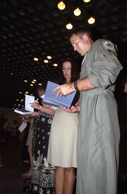 Colonel Rudy Wright, USAF, Commander 39th Wing and 39th Air and Space Expeditionary Wing, Incirlik Air Base, Turkey, and, his wife Samantha offer prayers for the thousands of Americans lost, and their grieving family members, during the terrorist attacks on the World Trade Centers Twin Towers and at the Pentagon. The candle light vigil was held at the base chapel in conjunction with National Prayer Day and Remembrance declared by President George W. Bush, 14 September 2001