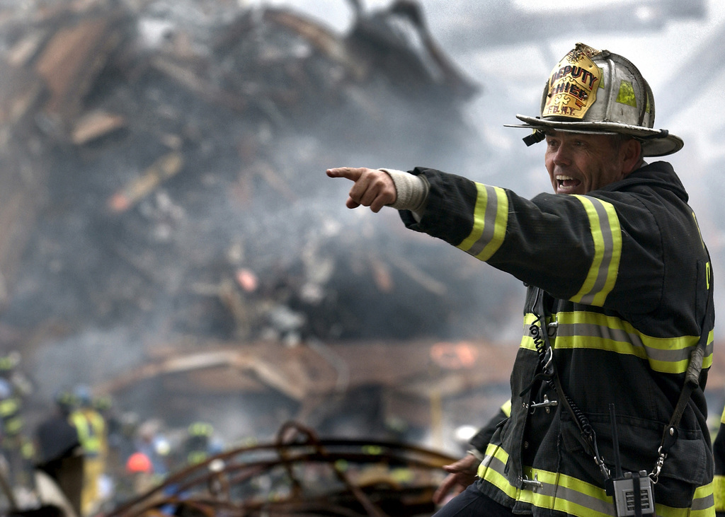 Joseph Curry, Deputy CHIEF, New York Fire Department, barks orders to rescue teams as firefighters and rescue teams search for survivors through the rubble and debris of the World Trade Centers in New York City in the area known as Ground Zero, after the 9/11 terrorists attacks