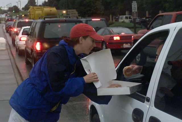 Megan Lucas, Executive Director, Bellevue Chamber of Commerce, hands out donuts to 55th Wing personnel as they inch their way toward the main gate of Offutt Airforce Base, Nebraska, on September 14, 2001. Higher security measures were implemented on September 11, 2001 after terrorist attacks on US soil, making it very difficult to get on base