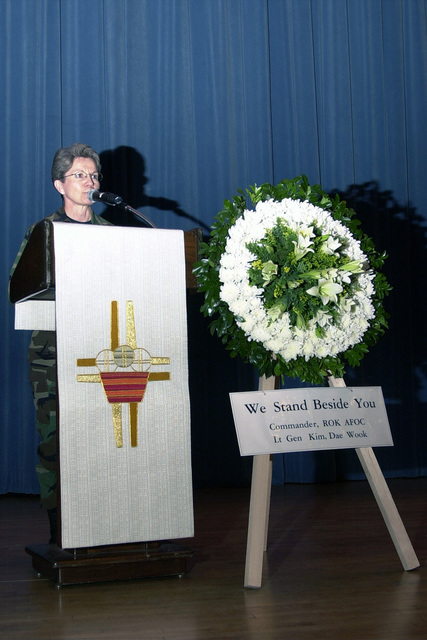 US Air Force (USAF) Chaplain Rita A. Lemons gives the opening prayer during the Memorial Service honoring the September 11th victims held at the base theatre at Osan Air Base Republic of Korea (ROK), following the attacks on the United States