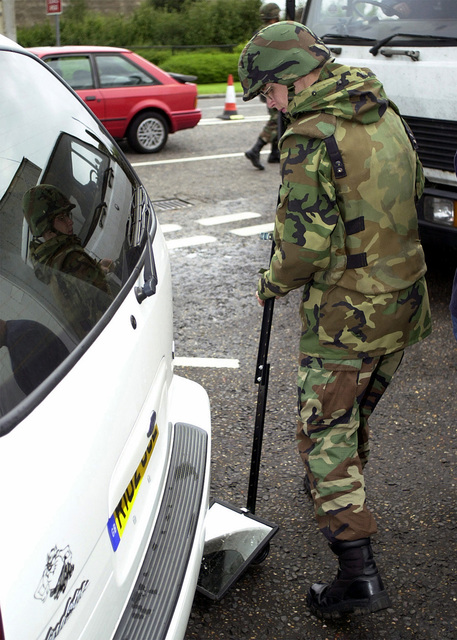 With stepped up security, a 48th Security Forces member inspects the undercarriage of a vehicle before granting it permission to enter RAF Lakenheath, UK. Shortly after 8 AM (EST) on September 11, 2001 in an attempt to frighten the American people, terrorist mounted attacks on the World Trade Centers Twin Towers and at the Pentagon. Hijackers deliberately flew civilian airliners into the buildings, killing themselves, the passengers and thousands on the ground. Security is always foremost at RAF Lakenheath, but security is even tighter to prevent another occurrence of the tragedies that struck New York and Washington D.C