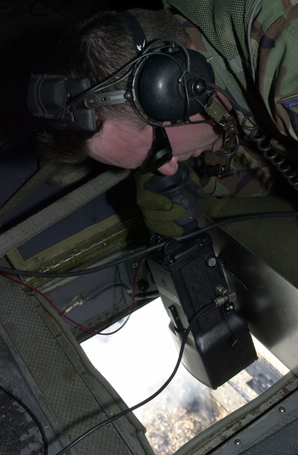 MASTER Sergeant (MSGT) Tony Laudcina, USAF, 305th Security Police Squadron (SPS), McGuire AFB, New Jersey, monitors a thermal imaging camera while flying over the rubble of the World Trade Center (WTC) in New York City. The hand held camera is mounted on a MH-53M helicopter from 20th Special Operations Squadron, Hurlbert Field, Florida. The 305th SPS is working with Federal Emergency Management Agency (FEMA) to aid engineers on the ground. The rescue and recovery efforts continue with tons of debris slowly removed from the WTC site