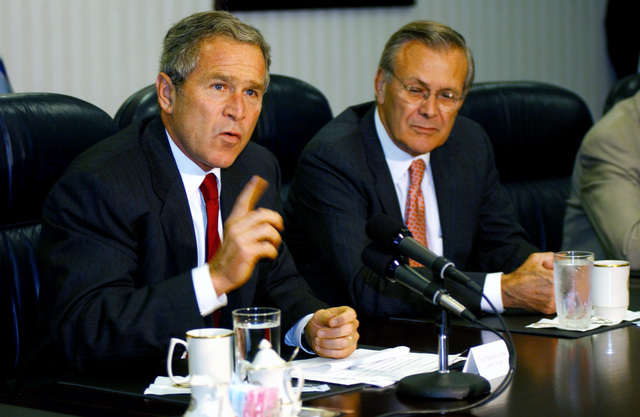 U.S. President George W. Bush (foreground) answers a question about Osama bin Laden during a media opportunity held after meeting with U.S. Secretary of Defense The Honorable Donald H. Rumsfeld (background) and the National Security team at the Pentagon on Sept. 17, 2001. (DoD photo by TECH. SGT. Cedric H. Rudisill) (Released)