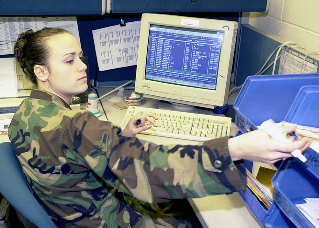 AIRMAN Shannon Harper, USAF, a postal clerk, 48th Communications Squadron, 48th Fighter Wing, RAF Lakenheath, UK, verifies that names and box numbers match in order to forward mail to the correct addresses at the post office