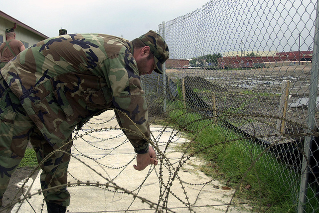 Soldiers from the 1ST Battalion, 279th Infantry, Oklahoma National Guard, called in from a local field training exercise, string razor wire around a civilian-contractor construction site on the Oklahoma Air National Guard Base, Tulsa International Airport. The extra measure was initiated in response to the terrorist attacks on World Trade Center and the Pentagon on September 11, 2001