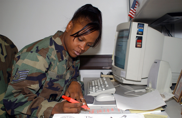 STAFF Sergeant (SSGT) Yvette Hughes, USAF, fuels support training manager, 86th Supply Squadron, Ramstein Air Base, Germany, highlights names on a training list