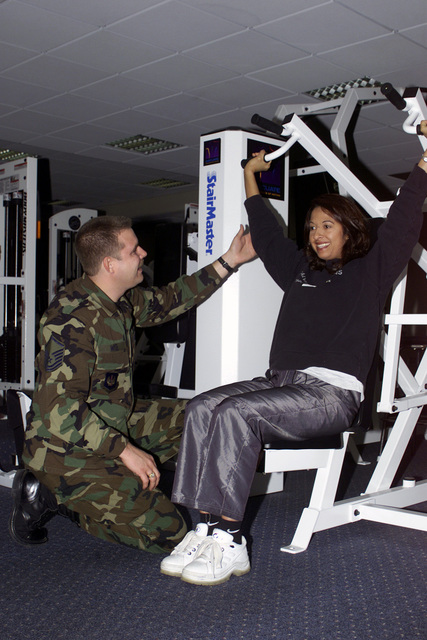 Superintendent MASTER Sergeant (MSGT) Anthony Wise, USAF, (left), of the shows Helen Hornsby the proper techniques on using the equipment at the Skelton Memorial Fitness Center. MSGT Wise assigned to the 52nd Services Squadron, 52nd Support Group, 52nd Fighter Wing, Spangdahlem Air Base, Spangdahlem Air Base, Germany