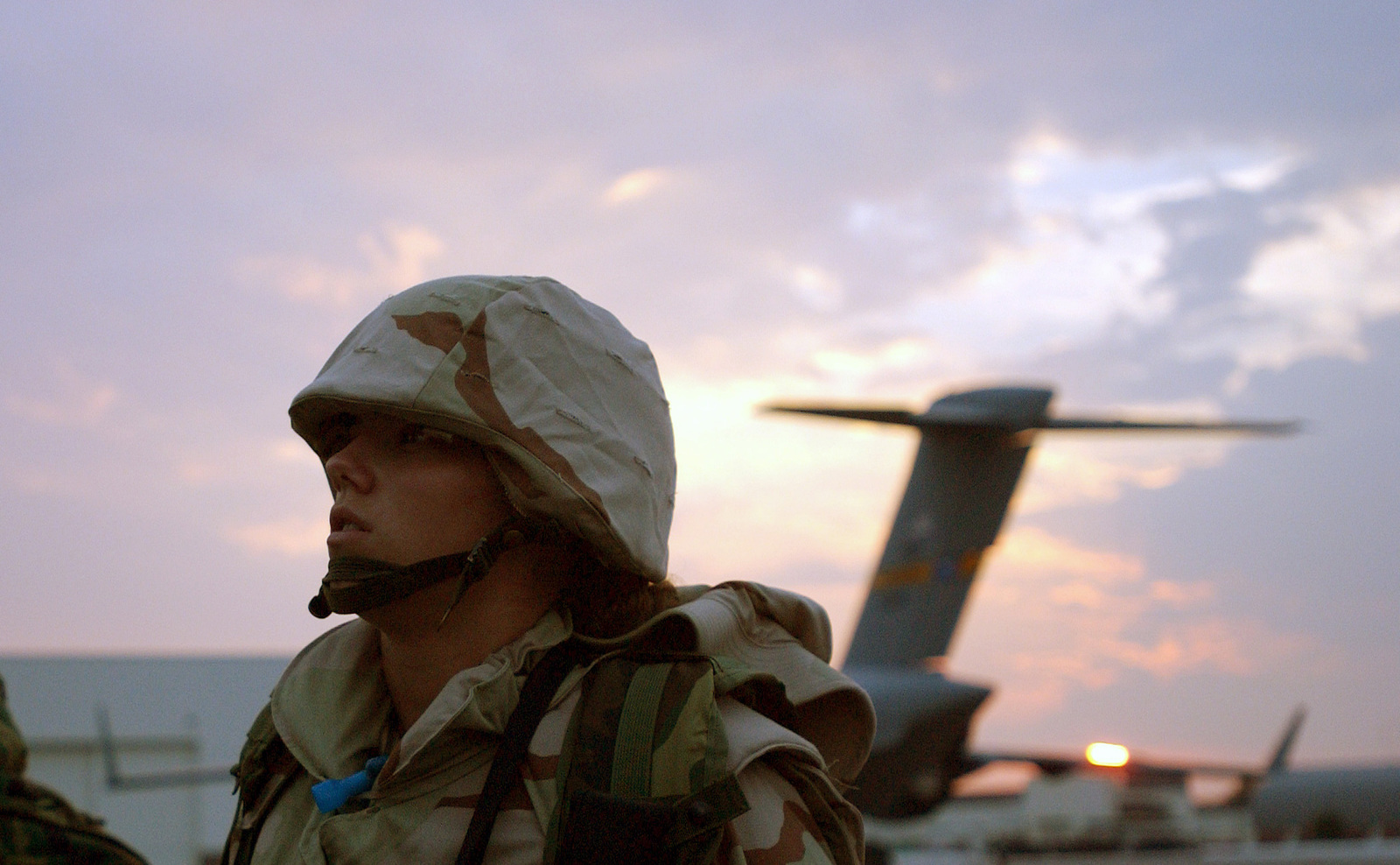 AIRMAN (AMN) Brandy Skoofalos, USAF, 437th Security Forces, Charleston AFB, South Carolina, on the ramp waiting to board an aircraft as she prepares to deploy to an unknown forward deployed location. She is one of many Air Force personnel mobilizing for the attack on terrorism during Operation ENDURING FREEDOM