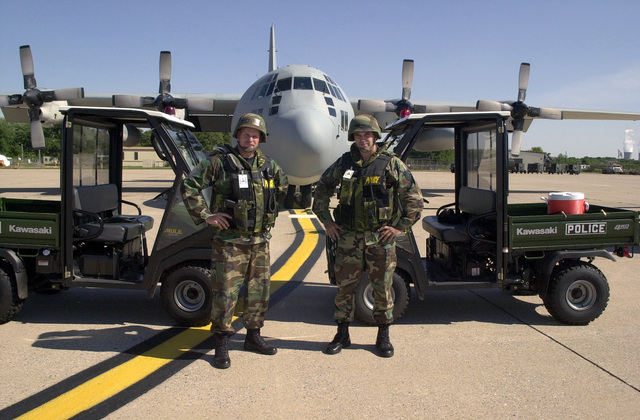 MASTER Sergeant (MSGT) John O'Brien (left) and STAFF Sergeant (SSGT) Jason Prough (right), 193rd Special Operations Wing (SOW), Security Forces, take a moment to pose for a photo while standing guard in front of the units EC-130E (Hercules) Commando Solo aircraft