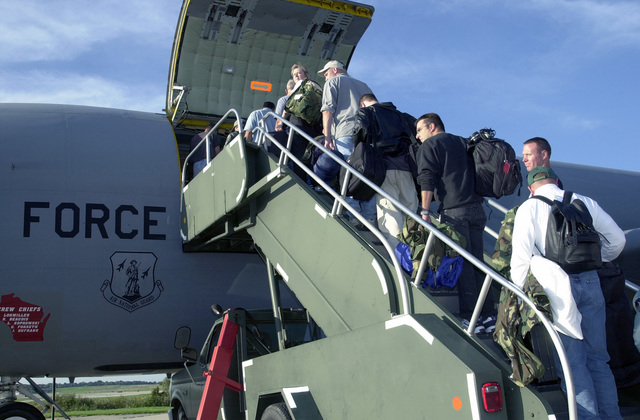Members of the 128th Air Refueling Wing (ARW) Wisconsin Air National Guard, climb the stairs to board the KC-135 Stratotanker. The 128th ARW deployed in support of Operation INFINITE JUSTICE. (Operation INFINITE JUSTICE later changed to Operation ENDURING FREEDOM)