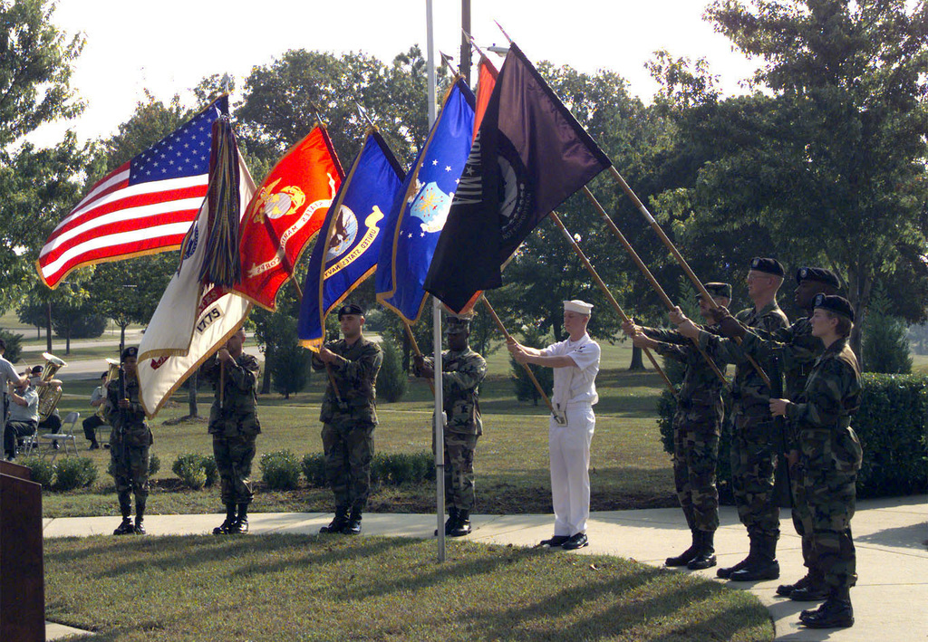 A Joint Service Color Guard presents the Flags during a