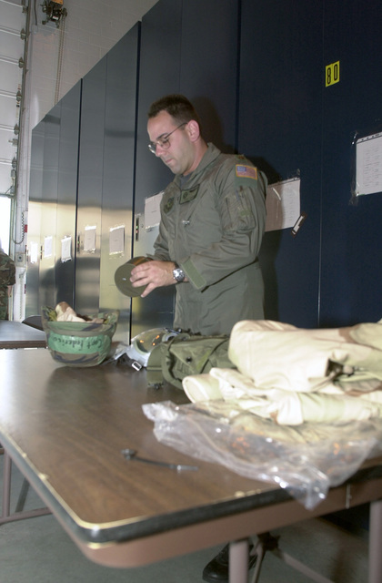 Major (MAJ) Mark Frederico, USAF, pilot, 193rd Special Operations Wing, checks his personal gear prior to packing for deployment in support of Operation ENDURING FREEDOM