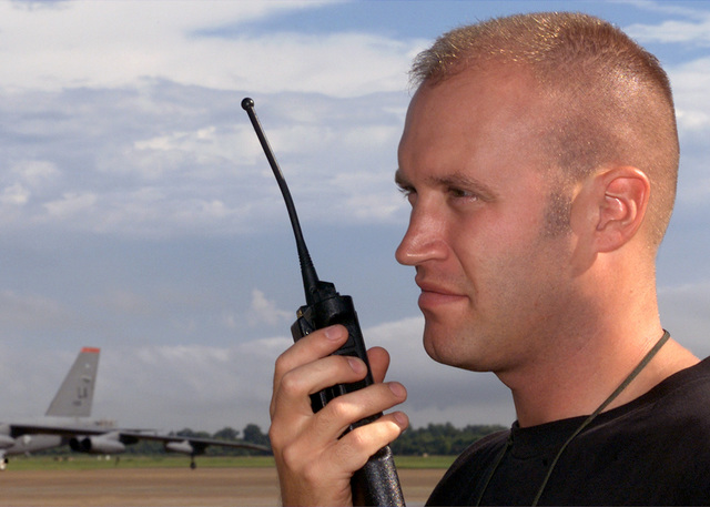 On the flightline at Barksdale AFB, Louisiana, STAFF Sergeant (SSGT) Brent Warren, USAF, 2nd Transportation Squadron, relays cargo preparation information via radio during Operation ENDURING FREEDOM