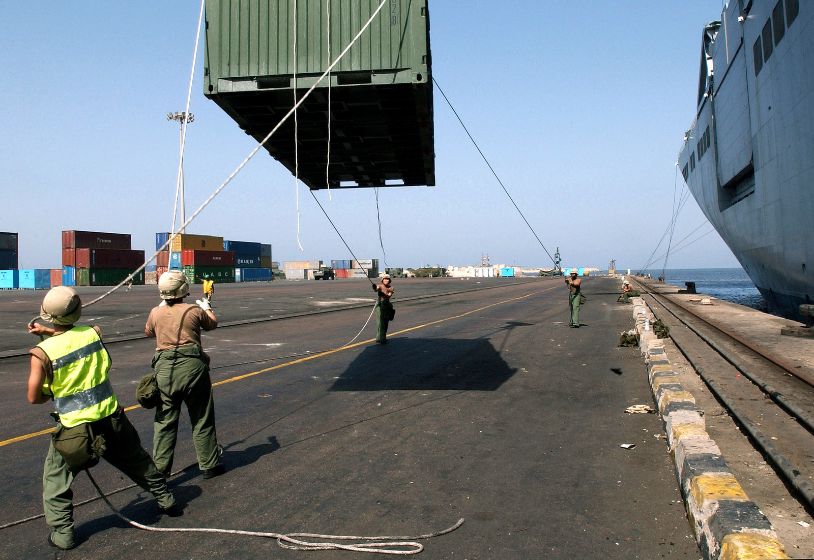 US Army (USA) 159th Transportation Detachment Soldiers off load containers from the Military Sealift Command (MSC) BOB HOPE CLASS; Large, Medium-Speed RO-RO ship USNS PILILAAU (T-ARK 304), at the Port of Dekheila, Egypt, during Exercise BRIGHT STAR 01-02. Bright Star is a multi-national exercise involving more than 74,000 troops from 44 countries that enhances regional stability and military cooperation among US Military, our key allies, and our regional partners