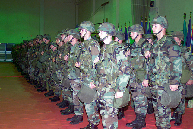 US Army (USA) Soldiers assigned to the 204th Military Police (MP) Battalion, stand in formation during a deployment ceremony inside the base gym, at Fort Polk, Louisiana (LA)