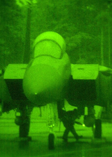 As seen through a night vision lens, a crewchief from the 494th Fighter Squadron, Royal Air Force Lakenheath, United Kingdom performs an end of runway (EOR) check on an F-15E Strike Eagle prior to releasing it for take off. Due to the extended periods of darkness during the winter months, the base shifted to night operations as of September 10th and will continue through March. F-15E Strike Eagles launch from RAF Lakenheath in the early evening and generally return around 1130PM (2330)