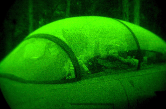 As seen through a night vision lens, Captain Doug Bartels, USAF, (left), pilot and Captain Mark Ciero, USAF, a Weapons System Operator (WSO), 494th Fighter Squadron, RAF Lakenheath, UK, prepare to taxi out for a night operation. Due to the extended periods of darkness during the winter months, the base shifted to night operations as of September 10th and will continue through March. F-15E Strike Eagles launch from RAF Lakenheath in the early evening and generally return around 1130PM (2330)