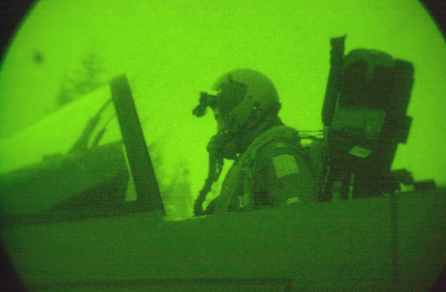 As seen through a night vision lens, Captain Doug Bartels, USAF, pilot 494th Fighter Squadron, RAF Lakenheath, UK, prepares for take off in an F-15E Strike Eagle. Due to the extended periods of darkness during the winter months, the base shifted to night operations as of September 10th and will continue through March. F-15E Strike Eagles launch from RAF Lakenheath in the early evening and generally return around 1130PM (2330)