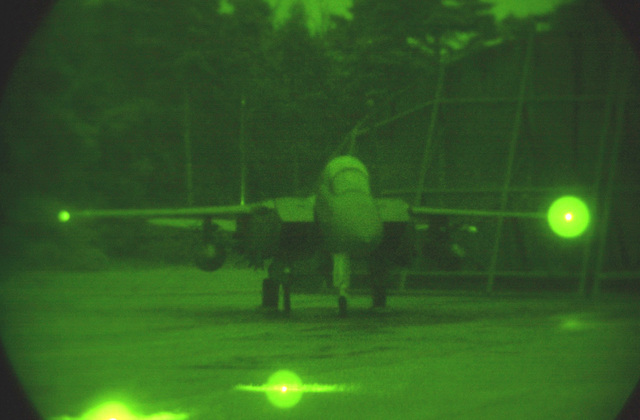 As seen through a night vision lens the F-15E Strike Eagle piloted by Captain Doug Bartels, USAF, and Captain Mark Ciero, USAF, Weapons System Operator, 494th Fighter Squadron, RAF Lakenheath, UK, prepares to taxi for take off. Due to the extended periods of darkness during the winter months, the base shifted to night operations as of September 10th and will continue through March. F-15E Strike Eagles launch from RAF Lakenheath in the early evening and generally return around 1130PM (2330)