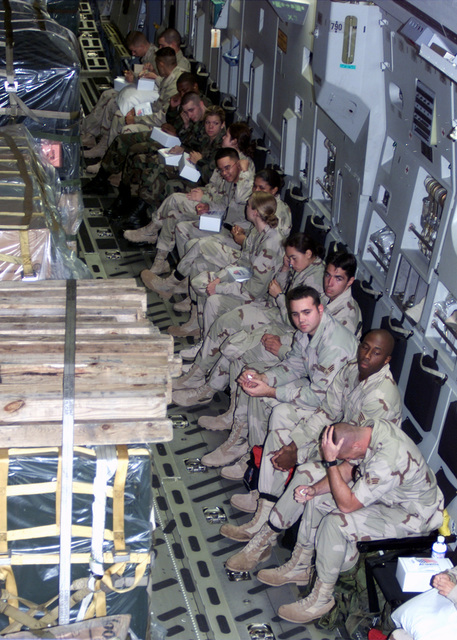 Interior view, cargo compartment of a US Air Force (USAF) C-17 Globemaster III aircraft at Barksdale Air Force Base, Louisiana (LA), showing US Military personnel and equipment deploying in support of Operation ENDURING FREEDOM