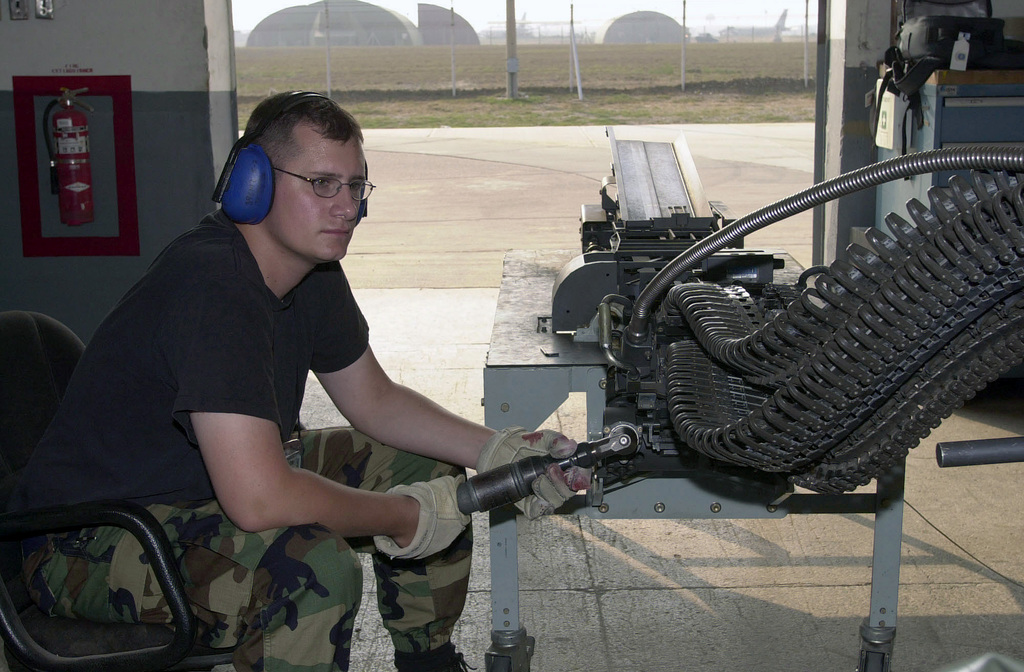 STAFF Sergeant (SSGT) Christopher Haider, USAF, 39th Maintenance Squadron (MXS), conventional maintenance crewchief, checks the Universal Ammunition Loading System (UALS) for any leftover rounds of 20mm ammunition. The system is checked after loading up an F-16 for a mission during its deployment in support of Operation NORTHERN WATCH, at Incirlik Air Base Turkey