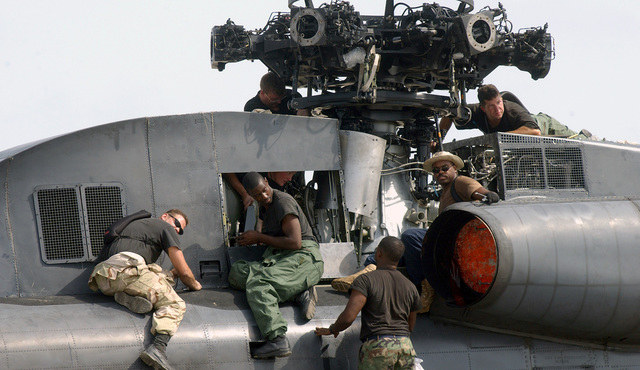 US Air Force (USAF) maintenance personnel assigned to the 16th Helicopter Generation Squadron, works to assemble a USAF MH-53 Pave Low helicopter at unknown forward location supporting Operation INFINITE JUSTICE