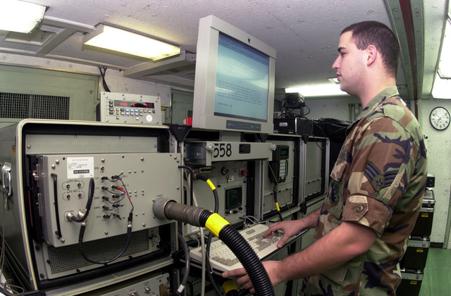 Using a Diagnostic Self-Tester, SENIOR AIRMAN Adam Weingarten, USAF, an Aviation Technician, 31st Maintenance Squadron, Aviano Air Base, Italy, performs a check on the test stations capabilities