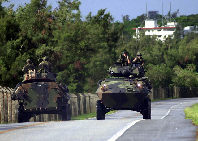 Two US Marine Corps (USMC) Light Amphibious Vehicles (LAV-25) are used to patrol the perimeter at Kadena AB, Japan. The LAV-25s are temporarily assigned to Kadena to provide security and are utilized to cross-train USMC and US Air Force (USAF) Security Personnel during Operation ENDURING FREEDOM