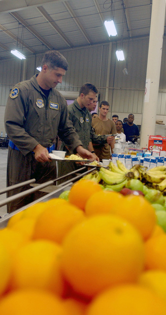 Major (MAJ) Martin Brunner, USAF, 14th Airlift Squadron, Charleston AFB, South Carolina, gets in line to be the first customer to eat at the new dining facility at an undisclosed forward deployed location. This dining facility will be supporting hundreds of troops participating in Operation ENDURING FREEDOM