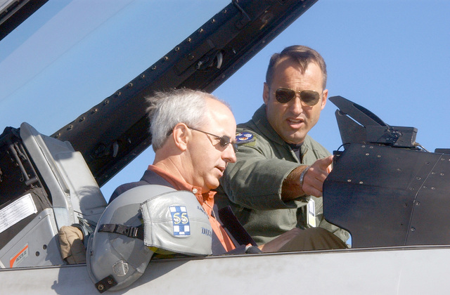 Colonel (COL) Tom Jones, USAF, Commander, 20th Operations Group, describes the use of the artificial horizon on the F-16CJ to South Carolina Governor Jim Hodges (D) during the governors visit to Shaw AFB
