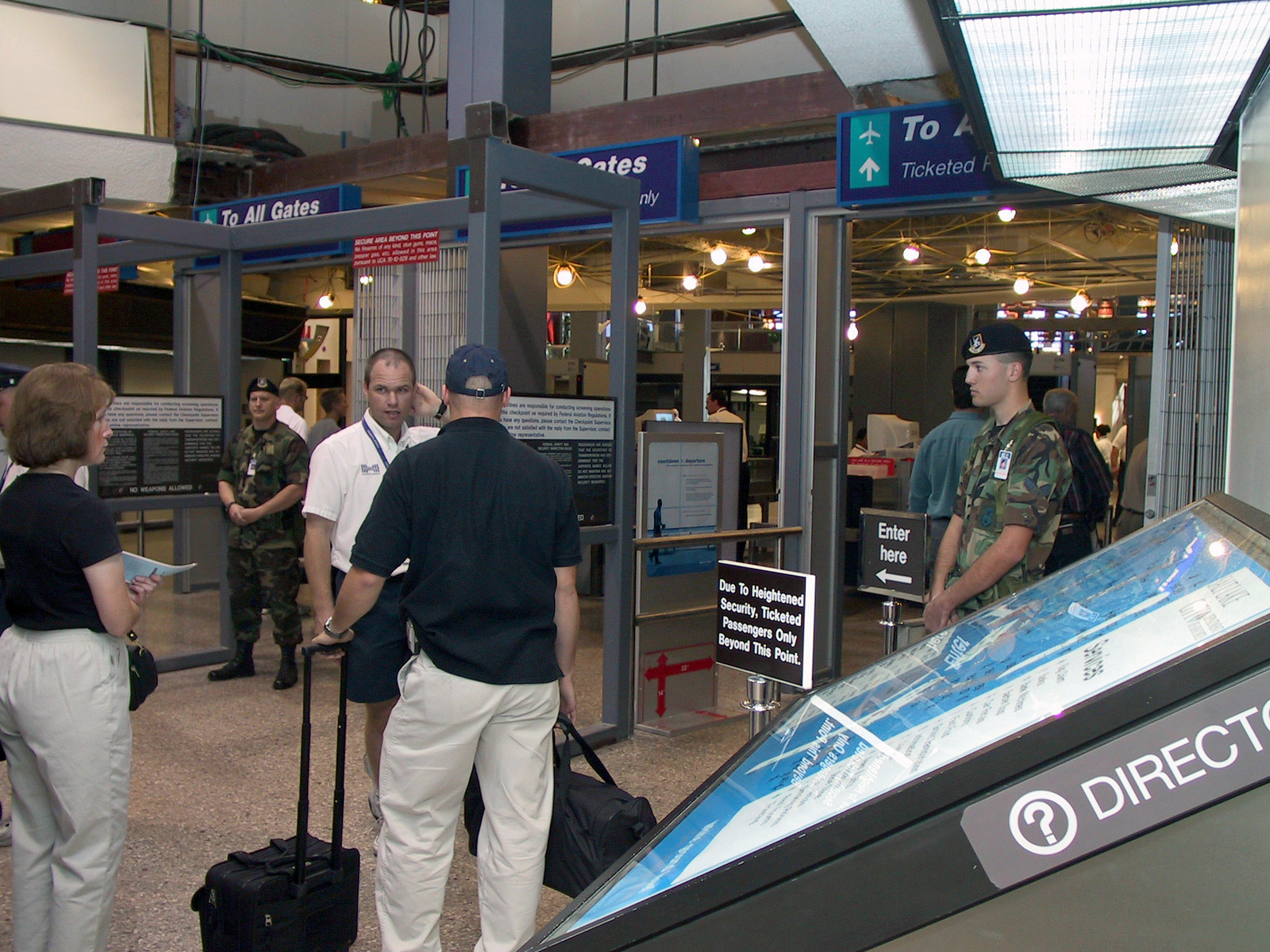 SENIOR AIRMAN (SRA) Andrew Haywood, (right), USAF, 151st Security Forces Squadron (SFS), stands guard at the Salt Lake International Airport, September 28, 2001. Utah's governor activated the Utah Air Guardsman in support of Operation NOBLE EAGLE