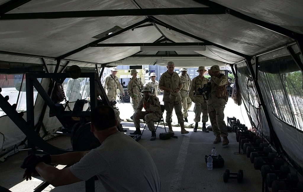 US Army (USA) Major General (MGEN) James Comstock, (standing center) CHIEF-of-STAFF for Exercise BRIGHT STAR and his staff view the fitness center at the Agami Military Complex at West Cairo, Egypt, during Exercise BRIGHT STAR 01-02. Bright Star is a multi-national exercise involving more than 74,000 troops from 44 countries that enhances regional stability and military cooperation among US Military, our key allies, and our regional partners