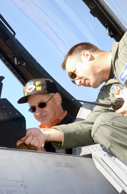 With South Carolina Governor Jim Hodges (D) sitting in the cockpit, Colonel (COL) Tom Jones, USAF, Commander, 20th Operations Group, points out various instruments used to fly the F-16CJ